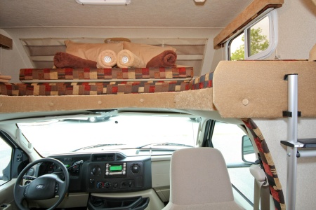 driver's cabin and bed in roof canopy