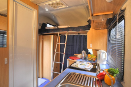 kitchen and bed in roof canopy